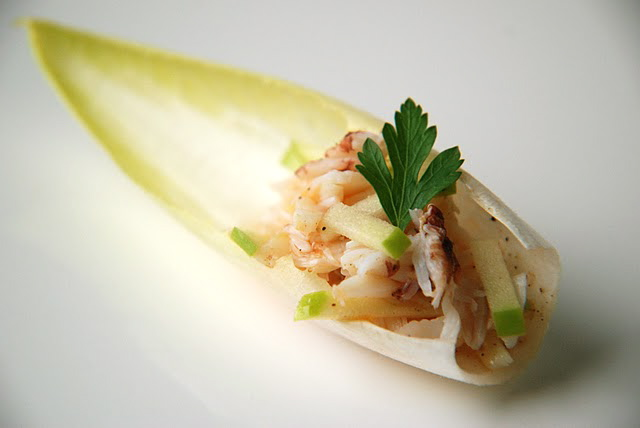 Crab and apple salad in endive petals