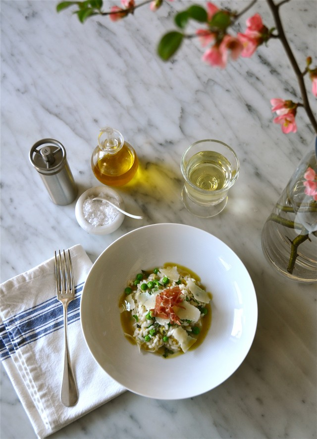 Pea risotto with prosciutto and basil oil