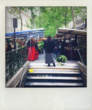 Selling Lily of the Valley at the entrance to the Raspail market
