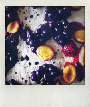 Roasting plums and grapes