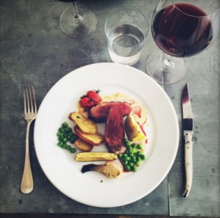 Duck breast with spring vegetables